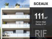 T4 de 111 m² avec rooftop 91 m²